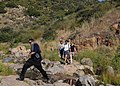 US Navy 110525-N-KA543-045 Naval Medical Center San Diego patients and staff cross a creek in the Mission Trails Regional Park during a recreationa.jpg