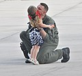 US Navy 110617-N-RR409-068 Naval Air Crewman 1st Class James Davis, assigned to Helicopter Sea Combat Squadron (HSC) 25, Det. 6, kisses his daughte.jpg