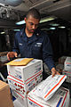 US Navy 111029-N-YZ751-187 Logistics Specialist 2nd Class David Gomez sorts incoming mail on the mess decks aboard the guided-missile destroyer USS.jpg
