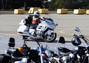 US Navy 111115-N-YM863-010 Traffic safety instructor from Cape Fox Professional Services, demonstrates driving the course.jpg