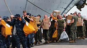 US Navy 111212-N-FH966-221 Sailors and Marines move mail onto the amphibious assault ship USS Makin Island.jpg