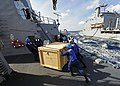 US Navy 111221-N-VH839-022 Sailors aboard the Arleigh Burke-class guided-missile destroyer USS Dewey (DDG 105) remove a cargo box from the pallet l.jpg