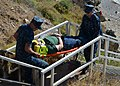 US Navy 120119-N-CD652-003 Emergency Technician (EMT) trainees Hospitalmen Paul Boss and Kevin Corcoran carry simulated fall victim Hospitalman Wil.jpg