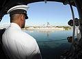 US Navy 120123-N-BK435-099 Chief Yeoman Bernard Green mans the rails as the ship passes the USS Missouri (BB 63) Memorial for a port visit.jpg