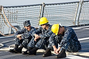 US Navy 120206-N-LZ908-043 Fire Controlman 3rd Class Joshua Ortiz and Sonar Technicians 3rd Class Eric Hernandez and Luke Miner take a break on the.jpg