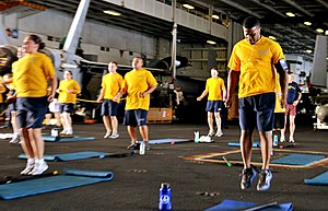 US Navy 120216-N-JY929-130 Culinary Specialist 1st Class Bryant Hill participates in a Carrier Strike Group (CSG) 9 staff physical training session.jpg