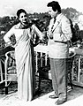 "Uttam And Suchitra in ""Pothe holo Deri"".jpg"