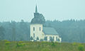 Västervåla kyrka i brandrök 4443.jpg