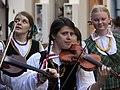 Vilnius Ethnic Festival Parade Violin Players (4769883039).jpg