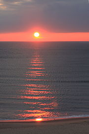 Virginia Beach sunrise reflected off water.jpg