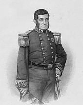 Engraved three-quarters portrait of a dark-haired man standing, dressed in a double-breasted, embroidered military tunic with his left hand on the pommel of his sheathed sword and his right hand holding a bicorn hat