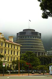 Left: The old Government Buildings (now occupied by the Victoria University of Wellington Law Faculty); Centre: the Beehive, Parliament's Executive Wing. Parliament House is just visible to the right.