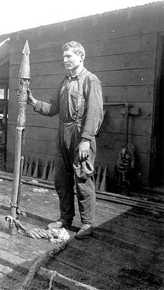 Whaling in the United States - Alaskan whaler standing with a harpoon, 1915