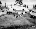 Wild West Show practicing in corral behind the Gold Camps of Alaska exhibit, Pay Streak, Alaska Yukon Pacific Exposition (AYP 599).jpeg