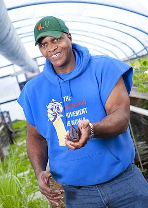 Will Allen (urban farmer) - Allen holds a tilapia in his hand at the urban farm Growing Power
