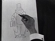 A hand holding a pen draws a portly cartoon figure on paper.