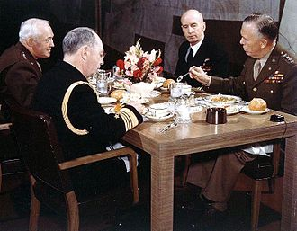 Joint Chiefs of Staff - Joint Chiefs of Staff meeting (circa 1943). From left to right are: Gen. Henry H. Arnold, Chief of the Army Air Forces; Adm. William D. Leahy, Chief of Staff to the Commander in Chief of the Army and Navy; Adm. Ernest J. King, Commander in Chief, U.S. Fleet and Chief of Naval Operations; and Gen. George C. Marshall, Chief of Staff of the United States Army.