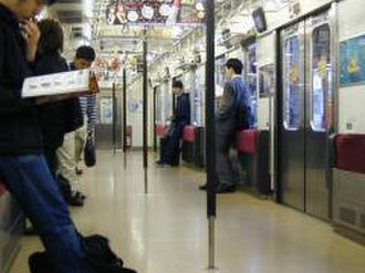 205 series - Interior of a former Yamanote Line 205 series 6-door car in April 2002