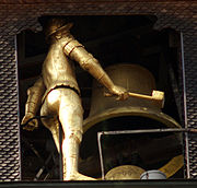 Detail: Gilded bell-striker and hour bell. Below, the top of the smaller quarter-hour bell.