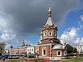 Часовня Успенского собора во имя Александра Невского на фоне летних облаков.jpg