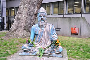 Secular ethics - Valluvar (a theist who wrote a secular text) statue in SOAS, University of London.