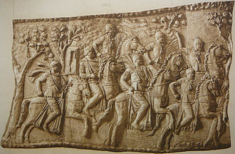 Tiberius Claudius Maximus - Cast (Cichorius 104) of panel on  Trajan's Column, showing start of sequence leading to the capture and death of Dacian king Decebalus. Roman ala cavalry troopers (those wearing neck kerchiefs and mail cuirasses, presumably from Maximus' regiment,  Ala II Pannoniorum) and Praetorian Horseguards (troopers wearing mantles, foreground) ride out in pursuit of Decebalus and his remaining supporters. (The previous panel (Cichorius 103) shows many Dacian pileati (noblemen) surrendering to Roman emperor Trajan)