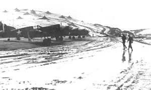 Amchitka Air Force Base - 18th Fighter Squadron P-40s, March 1943.  Note the personnel tents on the hill to the north of the aircraft.