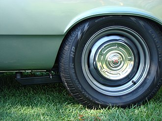 """Hubcap - """"Dog dish"""" cap on a painted steel wheel"""