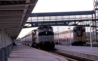 California Car (railcar) - California Cars on San Joaquin and Capitol Corridor trains at Oakland in 1998. Take note of the California Cab Car's square headlight configuration which, in later years of service, was not FRA compliant. The headlights were changed in 2005 to form a triangular headlight configuration which was the standard FRA headlight requirement.