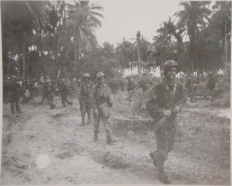 3rd Marine Regiment (United States) - Men of 1st Battalion emerge from the jungle during the Bougainville campaign