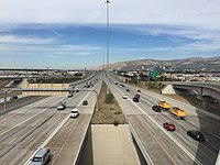 2015-09-29 13 56 14 View north along Interstate 15 and west along Interstate 80 looking towards Salt Lake City, Utah from South Salt Lake, Utah.jpg