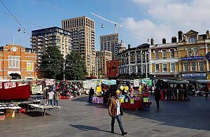 Beresford Square - Beresford Square with market stalls, Royal Arsenal Gatehouse and Crossrail towers