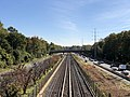 2018-10-25 11 44 00 View east along Interstate 66 (Custis Memorial Parkway) and the Orange and Silver lines of the Washington Metro from the pedestrian overpass connecting North Potomac Street to Madison Manor Park in Arlington County, Virginia.jpg