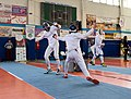 2nd Leonidas Pirgos Fencing Tournament. Lunge by the fencer on the left, 9th parry by the fencer Vasileios Stantsios.jpg