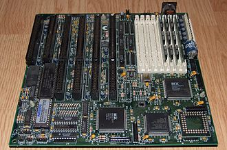 Motherboard - The Octek Jaguar V motherboard from 1993. This board has few onboard peripherals, as evidenced by the 6 slots provided for ISA cards and the lack of other built-in external interface connectors. Note the large AT keyboard connector at the back right is its only peripheral interface.
