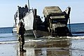 5 ton truck is backed onto a Landing Craft Utility as the 31st Marine Expeditionary Unit back-loads during exercise Tandem Thrust 2001 in Queensland, Australia.jpg