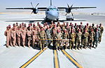 702d Expeditionary Airlift Squadron group photo.jpg