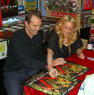 Michael Biehn - Biehn and his then-girlfriend, actress Jennifer Blanc, in 2012, promoting The Victim, which they co-produced, and which Biehn starred in and directed