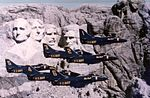 A-4F Skyhawks of the Blue Angles flying fly by Mount Rushmore in 1976.jpg