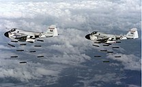 A-6A Intruders of VA-196 dropping Mk 82 bombs over Vietnam on 20 December 1968 (NNAM.1996.253.7047.013).jpg