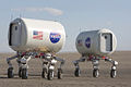 ATHLETEs with crew module mockups.jpg