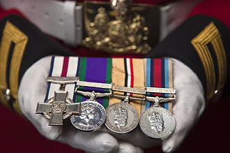Conspicuous Gallantry Cross - The CGC (left) as worn on a dress uniform with campaign medals. The medals shown are those awarded to Lance Corporal of Horse Andrew Radford, CGC.