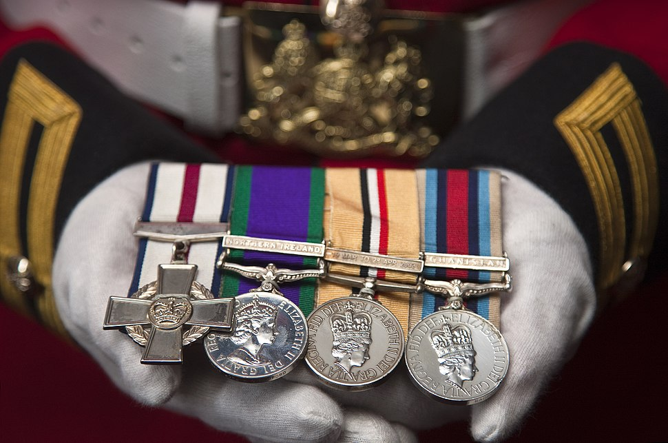 A Soldier Proudly Holds His Medals MOD 45153192