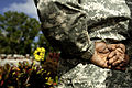 A Soldier stands at parade rest at the memorial for Cpl. Andrew Wilfahrt, a native of Rosemount, Minn., 552d Military Police Company, 728th MP Battalion, 8th MP Brigade, at Schofield Barracks, Hawaii, Feb 120227-A-TW035-001.jpg