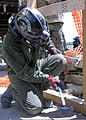 A U.S. Marine with the Chemical Biological Incident Response Force (CBIRF) hammers wooden bracing together to support a collapsing building during exercise Vibrant Response 13 at the Muscatatuck Urban Training 120729-A-AC168-001.jpg