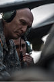 A U.S. Soldier assigned to the 4th Squadron, 6th Cavalry Regiment, 16th Combat Aviation Brigade, 2nd Infantry Division briefs Chief of Staff of the Army Gen. Raymond T. Odierno, left, about an AH-64D Apache 140224-A-KH856-929.jpg