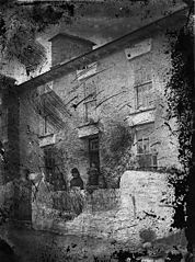 A family outside a house