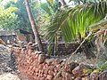 A typical compound for Konkan Homes using Laterite ( Jambha ) Stones - panoramio.jpg