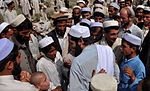 Afghan locals greet released detainee, coalition forces DVIDS215091.jpg