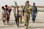 Afghan police conduct kite-making activity with Afghan children 110717-A-DM450-002.jpg